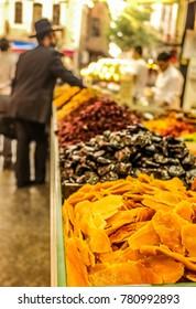 Dry fruits grocery on Mahane Yehuda Market (Jerusalem, Israel), blurred background