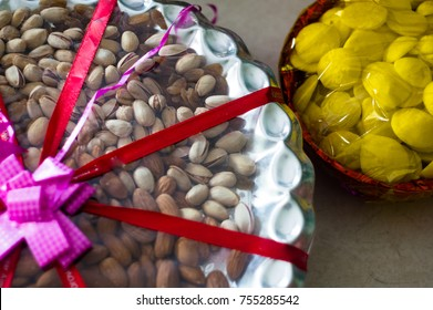 dry fruits and sweets packed in basket with cellophane and ribbons. Traditional during a hindu wedding ceremony