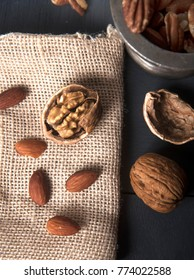 dry fruits : this 90 degree angle frame contains alomd, walnut, pecan nuts. Dry fruits are healthy, contain nutrients, which are helpful for human body growth.