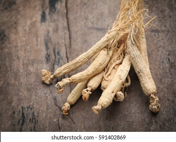 Dry Ginseng Roots on wood background ,with copy space.