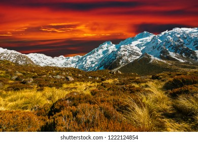 Dry grass at mountain hill with sunset sky background