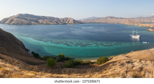 Dry grasses cover many of the islands in Komodo National Park, Indonesia. This region is known for its beautiful marine biodiversity.