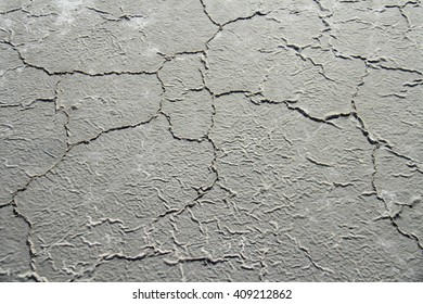 Dry gray earth with cracks
