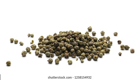 Dry green pepper pile, peppercorn isolated on white
