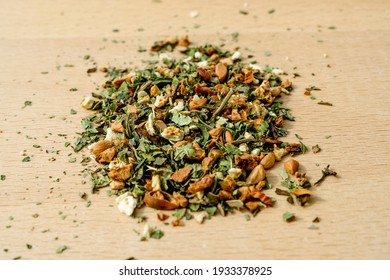 Dry green tea leaves with spirulina algae, buckwheat and dry plant roots. Delicious recipe for the detox benefits. High quality photo
