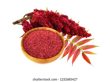 Dry Ground Sumac Spice with Drupe and Leaves. Isolated on White Background.