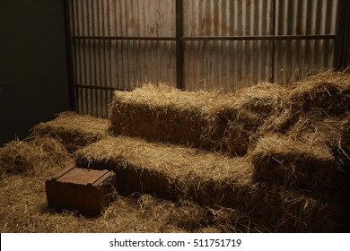 Dry hay stacks in wooden barn house interior