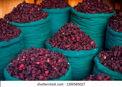 Dry herb hibiscus for tea in baskets. Arabic herbs on traditional bazaar. Natural organic food.