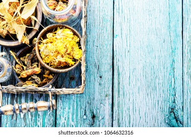 Dry herbs and plants in metal basket on a wooden background.Copy space.Herbs medicine.Healing herbs