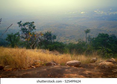 Dry, hilly Deccan plateau (India). Bush on slopes late winter, scrub jungle, table-like top of mountain