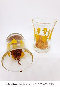 Dry instant coffee and  brown sugar in a transparent glass. Top view. Nescafe and sugar