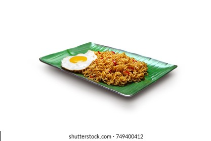 Dry Instant Noodle, Malaysian style maggi goreng mamak or spicy dry curry instant noodles with sunny side up egg with white background