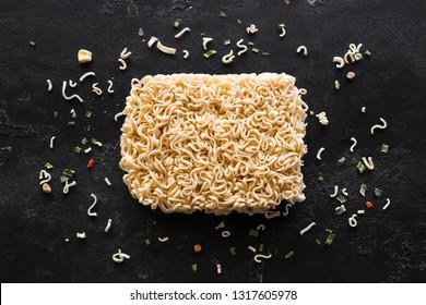 dry instant noodles on black background