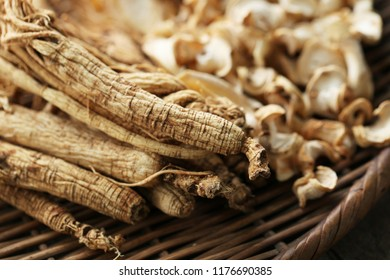 Dry Korean ginseng Roots on wood background.