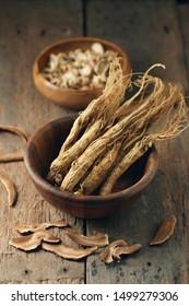 Dry Korean ginseng Roots on wood background.Korean herbal medicine.