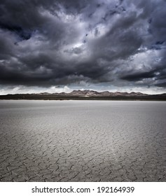 Dry lake bed with storm clouds