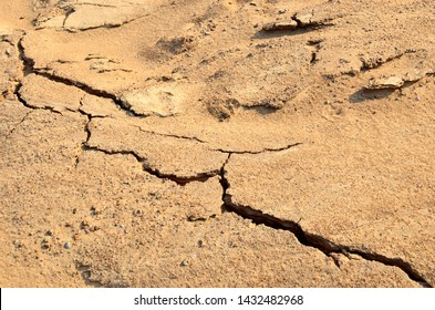 Dry lake or swamp in the process of drought and lack of rain or moisture, a global natural disaster. The cracked soil of the earth due to climate change. Background or texture of sand in mining quarry
