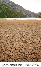 Dry land texture close up. Rough pattern. Global warming concept. No water. Climate change, Drought, Water Crisis, Nature disaster concept. Dry lake.