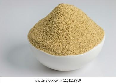 Dry mango powder - indian spice amchoor, isolated on white background