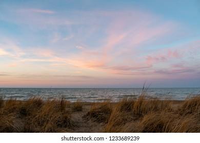 Dry marsh grasses under pastel sunset skies at the beach
