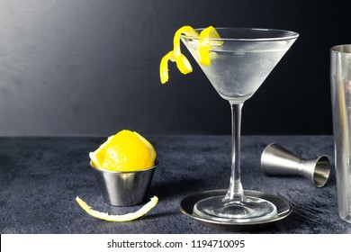 Dry Martini Cocktail With Lemon Twist, Lemon, Jigger and Mixing Glass, On Dark Background. Drink Photography