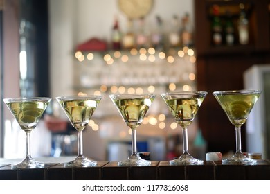 dry martini party at bar and bokeh light of cocktail background