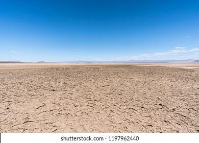 Dry Mojave desert lake with crusty mud patterns near Baker, California