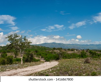 Dry mountain landscape with dirt road in Maasim, Sarangani Province on Mindanao, the southernmost large island of the Philippines.