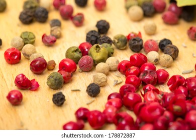 Dry multicolored peppercorn closeup on wooden background