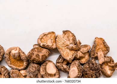 Dry Mushrooms isolated on white background. Japanese food. Some homemade Shiitake mushrooms (dried). The Shiitake (Lentinula edodes)  Shitake mushrooms ready to be cooked.