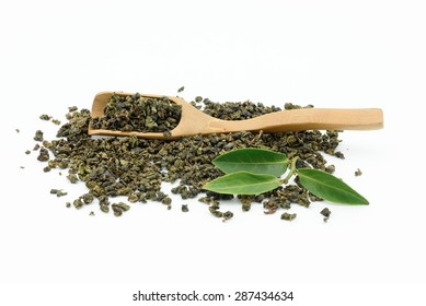Dry oolong tea leaf from China with bamboo scoop on white background.