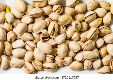 Dry organic Raw Pistachio Whole top view background or texture. Healthy spices, nuts, seeds and herbal products.