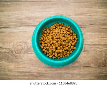 Dry pellet dog food made from plants or animals with nutrients that are good for the dog.