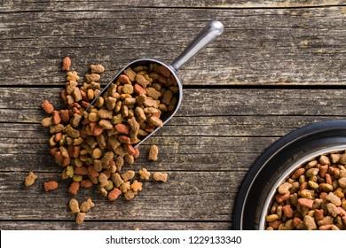 Dry pet food. Dry kibble food in scoop. Top view.