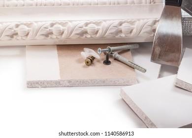 Dry plaster, screws, spatula, decorative molding from gypsum