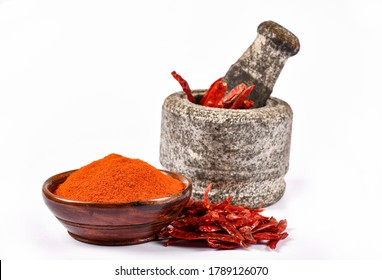 Dry Red chillies with Red Chilly Powder in Wooden Bowl on white background, Cayenne Pipper, Lal Mirchi, Mortar and Pestle, Indian Spices