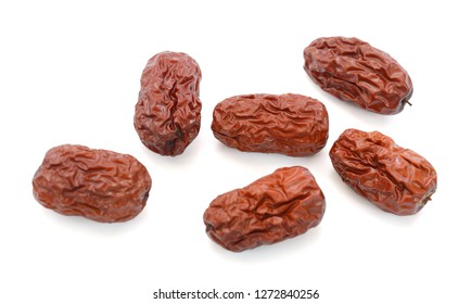 Dry red jujubes isolated on white background