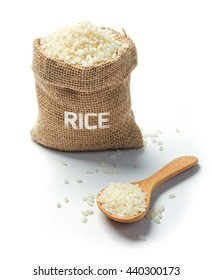 Dry rice with spoon grains in burlap