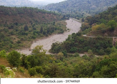 A dry river bed through hills in Timor Leste