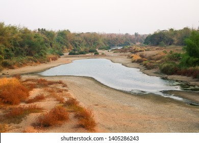 Dry river are caused by hot weather and drought in the summer.