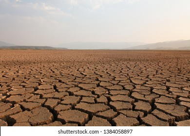 Dry river and lake after drought impact on summer, Landscape of Cracked earth metaphor climate change and global warming