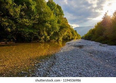 The dry riverbed of the Zinkenbach river in the autumn who ends in the Wolfgangsee in Austria