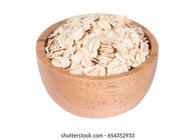 Dry rolled oat flakes oatmeal in bowl isolated on white background
