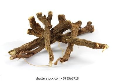 Dry roots of common chicory (Cichorium intybus).  Chicory root (Cichorii intybi radix) is used for the relief of symptoms of mild digestive disorders and temporary loss of appetite.