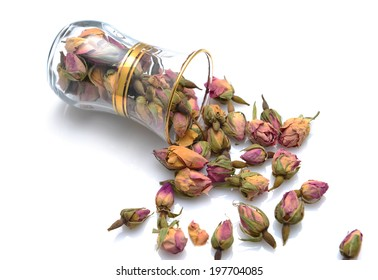Dry rose buds spilling from an arabic tea cup