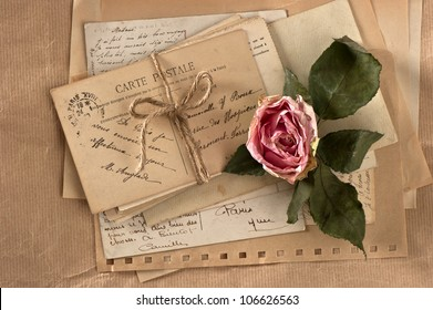 dry rose and old letters. vintage postcards and envelopes