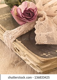Dry rose on an old book (sepia)