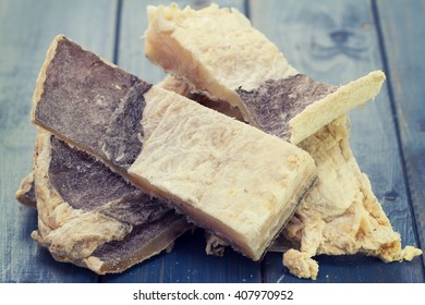 dry salted cod fish on blue wooden background