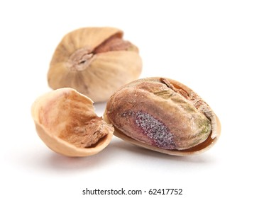Dry salted pistachio fruit isolated on white background