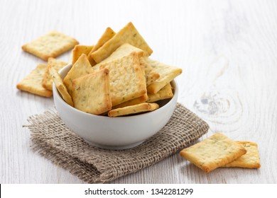 Dry salty cracker cookies in bowl on the table